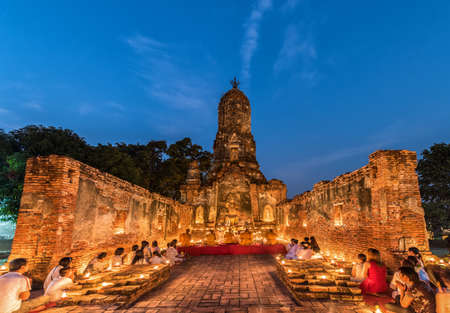 buddhist's: Ayutthaya, Thailand - February 22, 2016: People praying respect to monk on Ayutthaya. Roughly 95% of the Thai people are practitioners of Theravada Buddhism, the official religion of Thailand Editorial