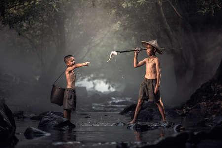Boy fishing in creeks