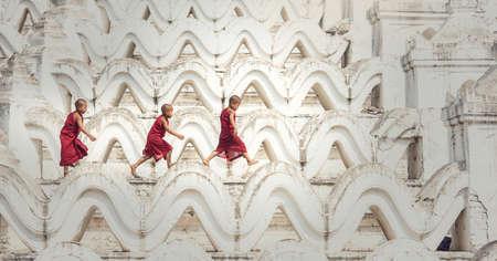 buddhist's: Buddhist novice are walking in temple, Myanmar