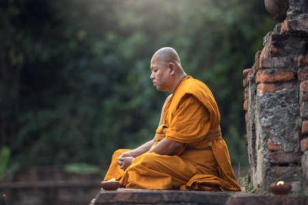 Buddhist monk meditation in temple