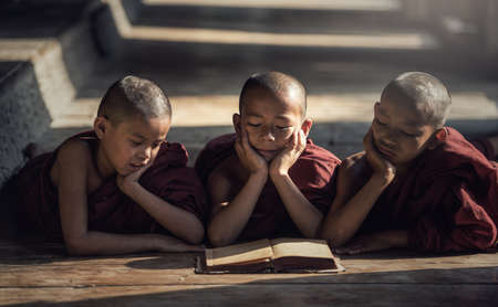 Novice monk reading book,in monastery, Bagan, Myanmar