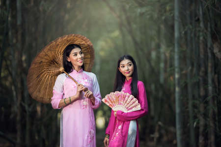 ao: Portrait of Vietnamese girl traditional dress, Ao dai is famous traditional costume for woman in Vietnam