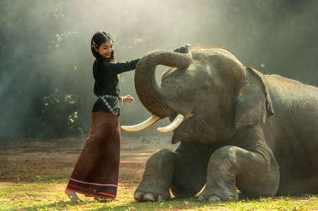 Elephant with Asian girl Stock Photo