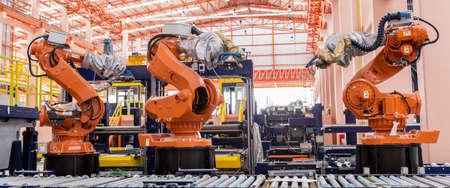 Lasrobotjes in een fabrieksfabrikant van de autofabrikant