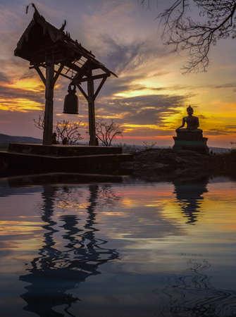 Buddha statue in sunset at Phrabuddhachay Temple Saraburi, Thailand Stock Photo