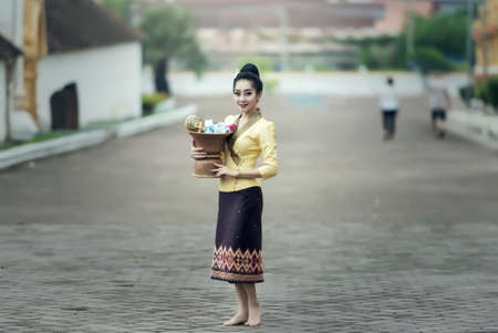 goodly: Asian woman in silk dress in temple Stock Photo