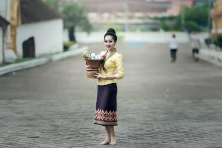 Asian woman in silk dress in temple Stock Photo
