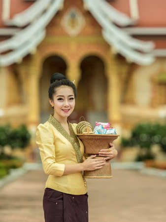 goodly: Young woman off smile of silk dress asian woman in silk dress in temple Stock Photo