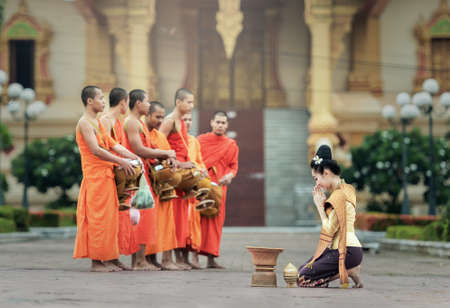 harity event: VIENTIANE, LAOS - JULY 29 : People give food offerings to Buddhist monks on July 29, 2016 in Vientiane, Laos.