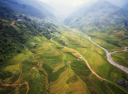 northwest: Aerial view of Rice fields on terraced of Mu Cang Chai, YenBai, Vietnam. Rice fields prepare the harvest at Northwest Vietnam.Vietnam landscapes.