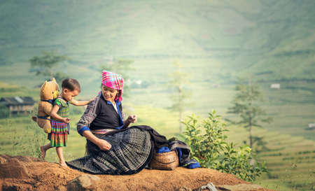 Family tribal mother and daughter in rice terraces,Tu Le Lao Cai,Vietnam Stock Photo