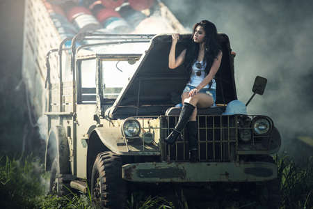 Asian model posing with old truck in an outdoor environment Stock Photo