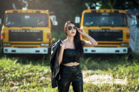 Asian model posing with truck in an outdoor environment