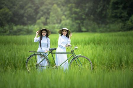 Portrait of Vietnam girls with Ao Dai, Vietnam traditional dress, Ao Dai is famous traditional costume for woman in Vietnam.