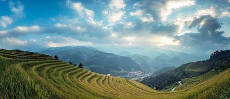 Vietnam landscape panorama scene. Vietnam Rice fields on terraced in rainy season at Mu cang chai, Vietnam. Rice fields prepare for transplant at Northwest Vietnam