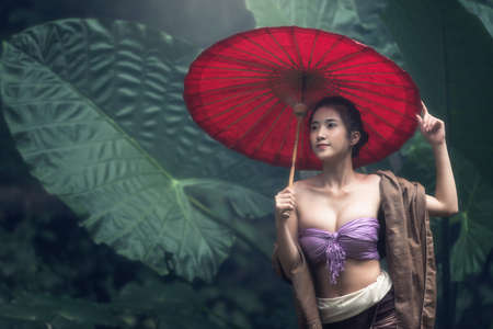 umbella: Asian Woman In Traditional Costume