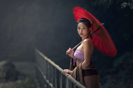 umbella: Asian Woman In Traditional Costume, Thailand Stock Photo