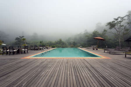 Nice swimming pool outdoors with mist in the morning
