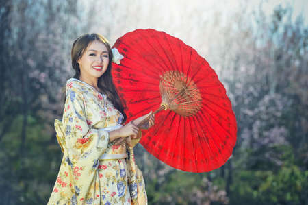 Asian women wearing traditional Japanese kimono