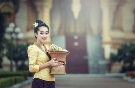Beautiful girl in Laos costume.Lao traditional dress of a beautiful woman Zdjęcie Seryjne