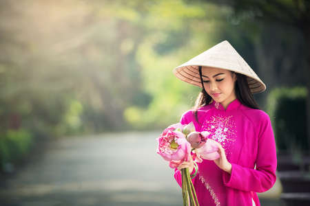 Beautiful woman with Vietnam culture traditional, Ao dai is famous traditional costume Stock Photo