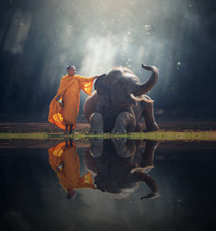 Monk and Elephant at Thailand contryside