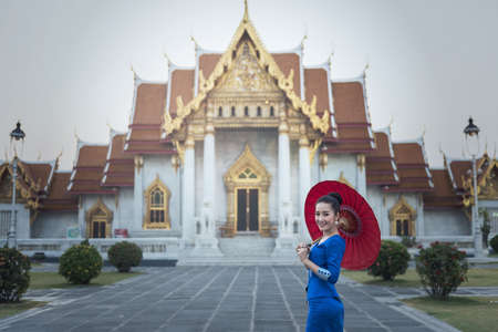 Tourist girl enjoying at Temple of the Emerald Buddha, Bangkok, Thailand.