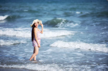 Pretty woman relaxing at tropical beach. Remote tropical beaches and countries. Travel concept.