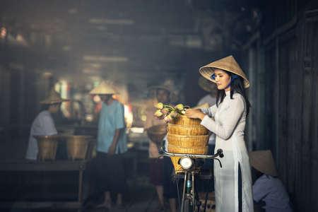 VIETNAM Beautiful women in Ao Dai Vietnam Traditional dress In market Concept portrait Ao Dai Vietnam.