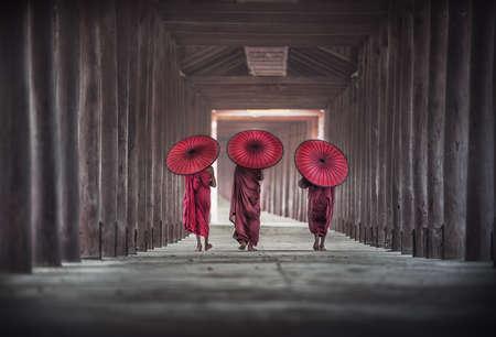 Back side of three Buddhist novice are walking in pagoda,Myanmar