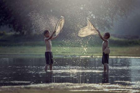 Asian boy fishing in the lake