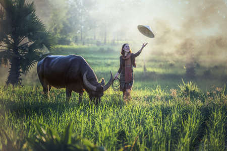 Portrait of Thai young woman farmer with buffalo, Thailand countryside Stock fotó