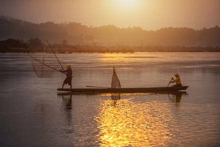 Fisherman on sunrise background at Thailand Countryside Stock Photo