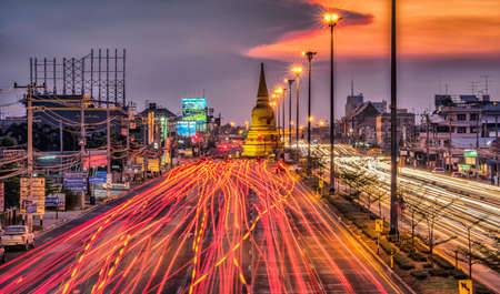 Light traffic on the road at night around the Pagoda,Ayutthaya. Thailand Imagens