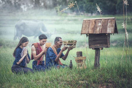 The traditional belief of Isan in Thailand, worship of Phi-Ta-Hak. Phi-Ta-Hak is the ghost of the rice fields. That preserves plants and gardens And take care to make the brown rice grow and fertile. Farming will be effective. Therefore have to make offerings to the Phi-Ta-Hak every year Stok Fotoğraf