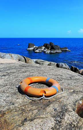 Broken Buoy on rock beach at Samui Island, Thailand