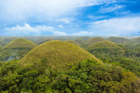 Chocolate Hills with blue sky in the green season, Bohol, Philippines