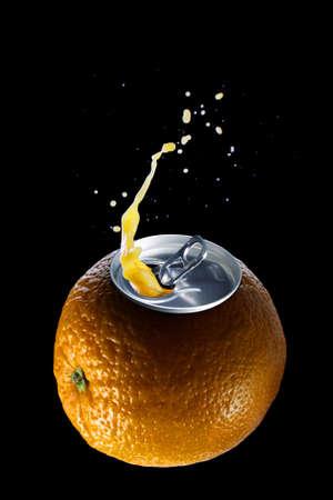 Open aluminium jar of orange juice. photo