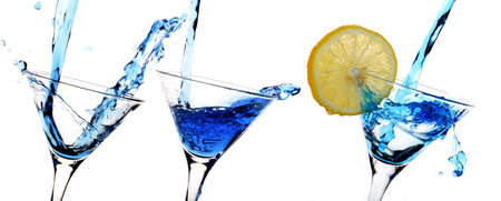 alcohol series: The alcoholic drink of dark blue colour flows in camps. Stock Photo