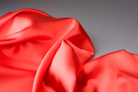 Red fabric on a grey background photo