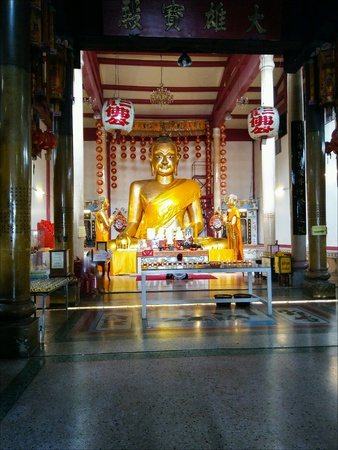 Golden buddha and disciples statue in temple