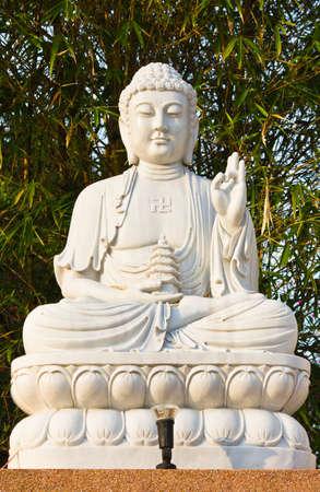 bodhisattva:  The sitting Bodhisattva Statue with bamboo background