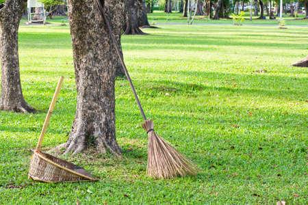 bristle: Traditional bristle broom and colorful autumn leafs in garden Stock Photo