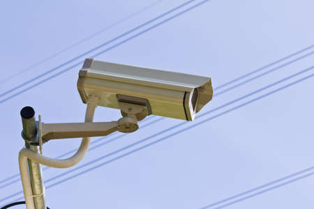 Surveillance Security Camera or CCTV on blue sky Stock Photo - 14220158
