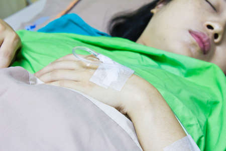 Woman patient sleeping in hospital bed  photo