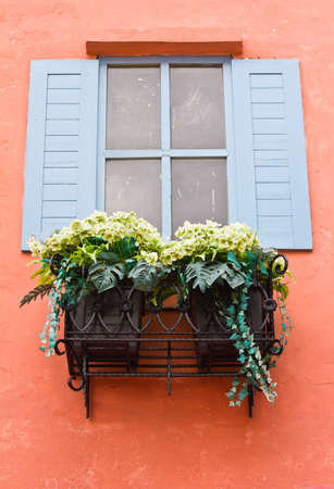 Open Window With Flower Basket On Orange  photo