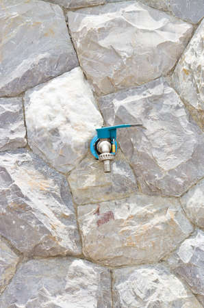 Faucet on the background wall stone  photo
