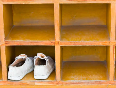 Shoes, boots stand on a rack  photo