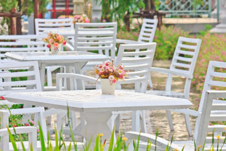 Tables, chairs, white outdoor patio photo