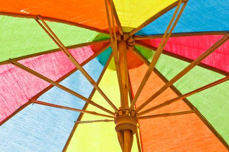 sunny south: Multicolored umbrella  Stock Photo